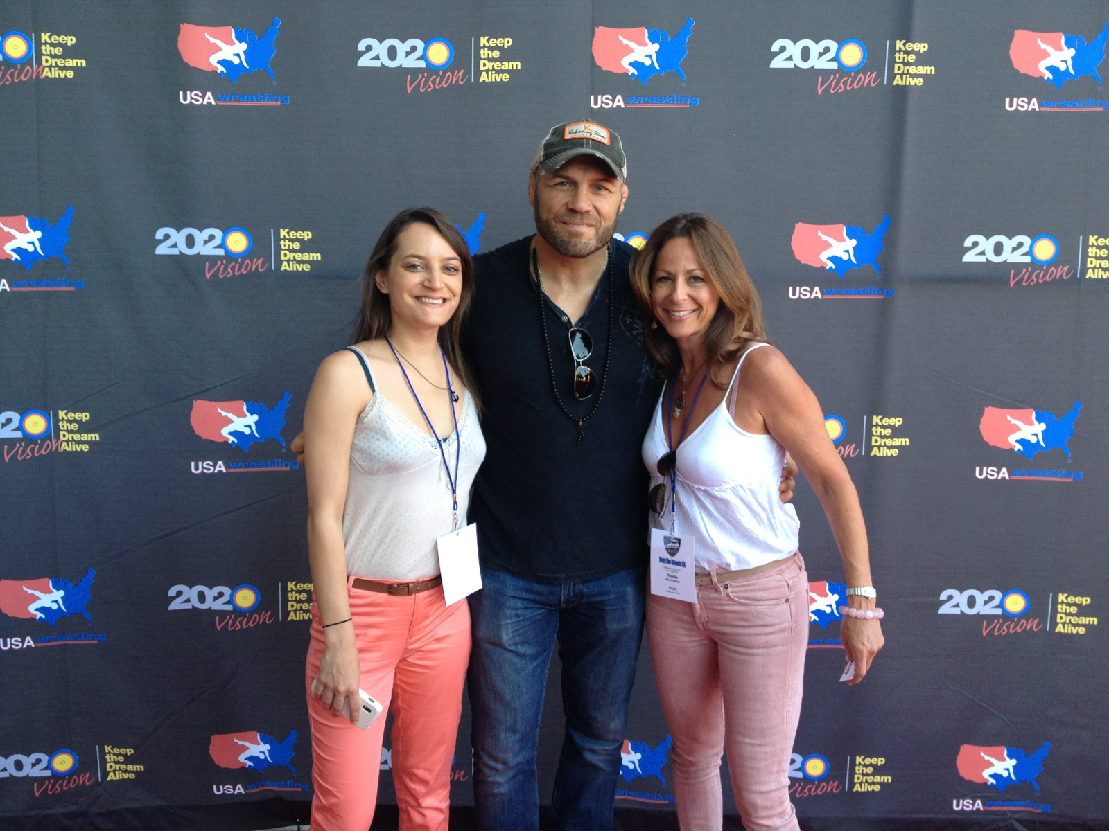 SportsTravel's Nicole Goddeyne and Lisa Furfine with MMA star Randy Couture on United 4 Wrestling's red carpet.
