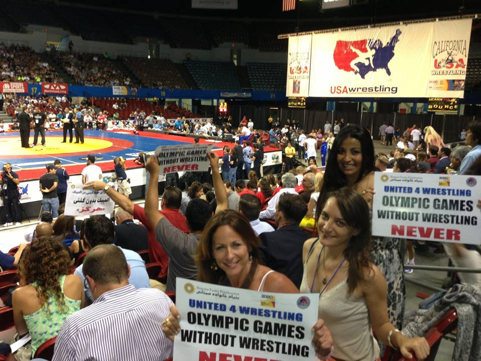SportsTravel's Lisa Furfine, Nicole Goddeyne and Yvonne Garcia show their support for the sport of wrestling.