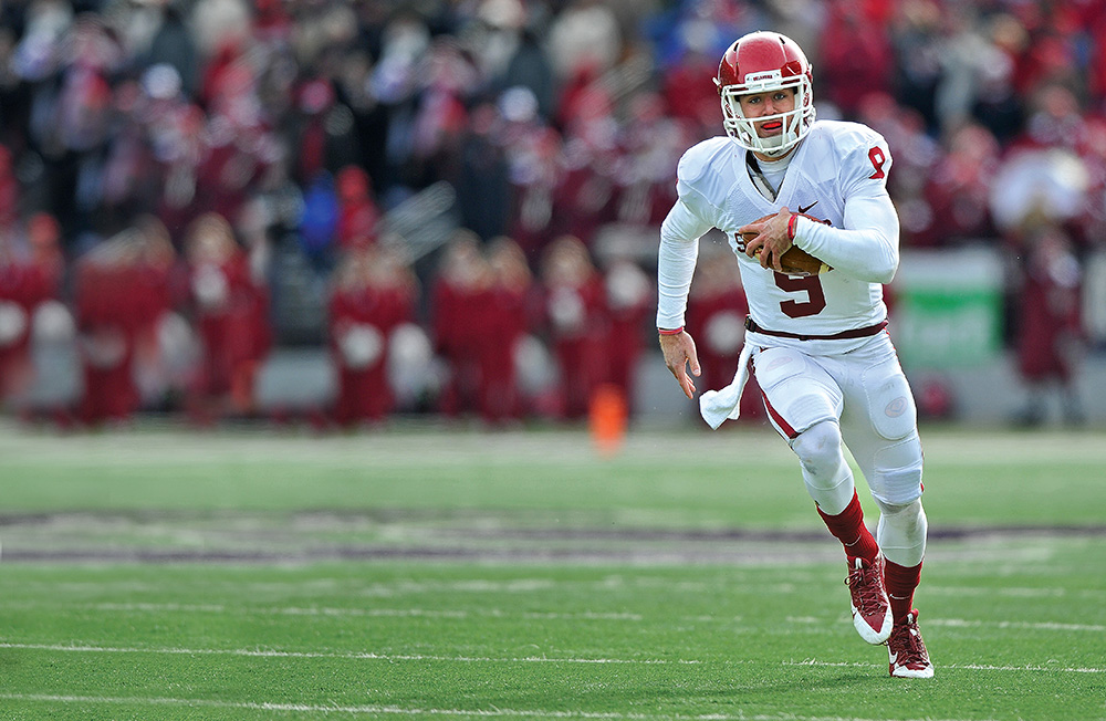 The Oklahoma Sooners, led by quarterback Trevor Knight, are a favorite to earn one of four spots in the new College Football Playoff. Photo by Peter G. Aiken/Getty Images