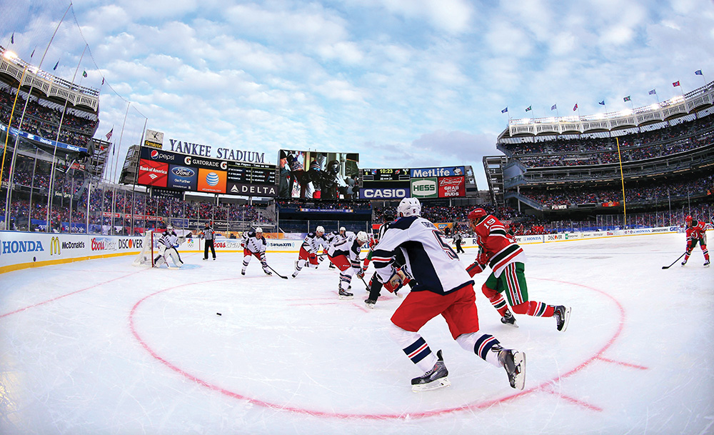 Yankee Stadium hosted two outdoor hockey games last season, including a match between the New York Rangers and the New Jersey Devils. Photo courtesy of Brad Penner/USA Today Sports