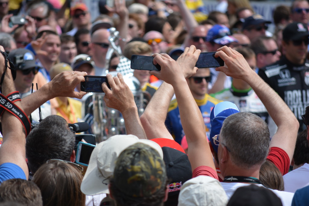 Fans used their phones to capture images of their favorite drivers before the race.