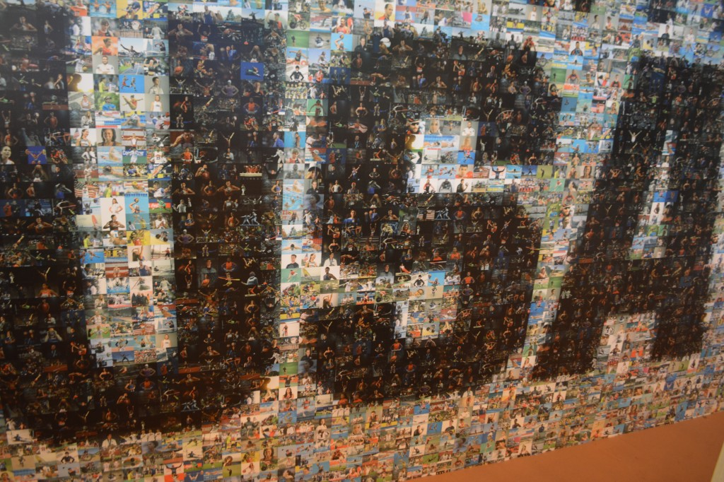 A mural of small photos of all 555 members of Team USA.